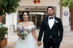 A bride and a groom on campus